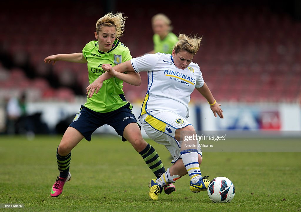 Emma Follis of Aston Villa Ladies is challenged by Carey Huegett of Leeds United Ladies during the FA Women's Premier League Cup Final match on May 05, 2013 in York, England.