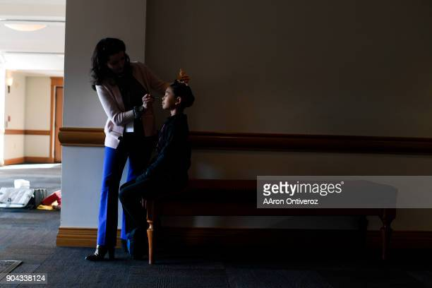 Emma Garcia receives makeup from Olga Balbocean during the 2018 Youth America Grand Prix semifinals at the University of Denver's Newman Center for...