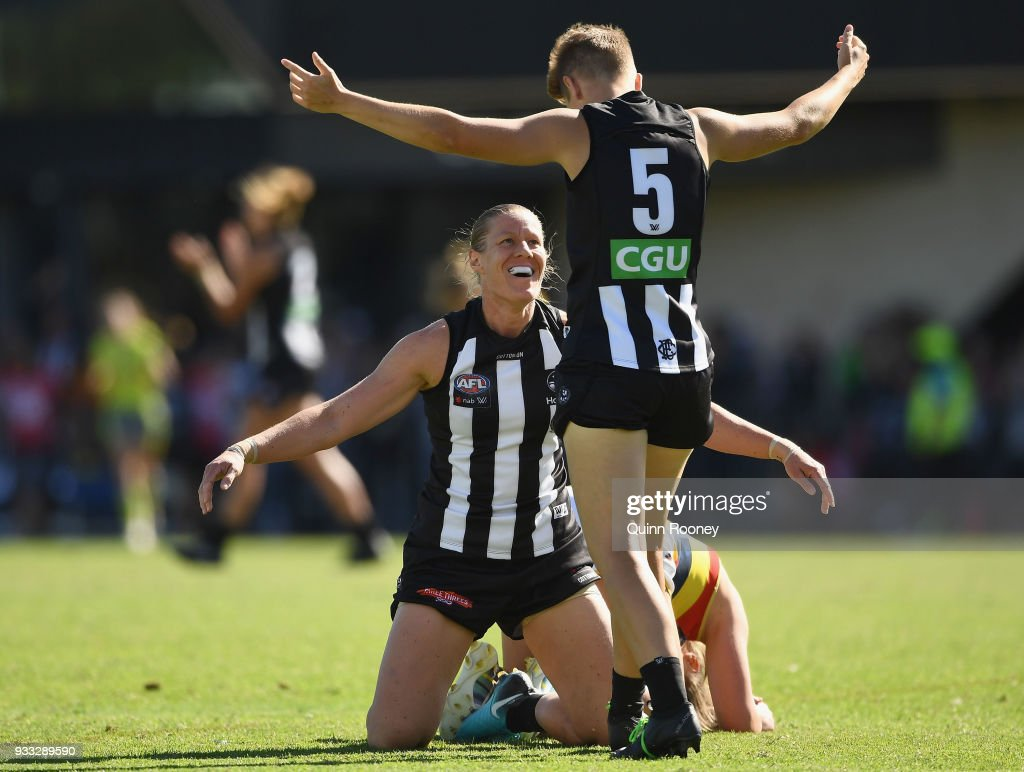 Emma Grant and Meg Hutchins of the Magpies celebrate winning the round seven AFLW match between the Collingwood Magpies and the Adelaide Crows at Olympic Park on March 18, 2018 in Melbourne, Australia.