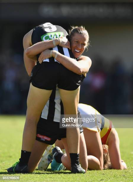 Emma Grant and Meg Hutchins of the Magpies celebrate winning the round seven AFLW match between the Collingwood Magpies and the Adelaide Crows at...