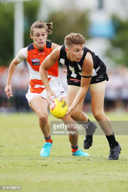 Emma Grant of the Magpies handballs during the round three AFLW match between the Collingwood Magpies and the Greater Western Sydney Giants at...