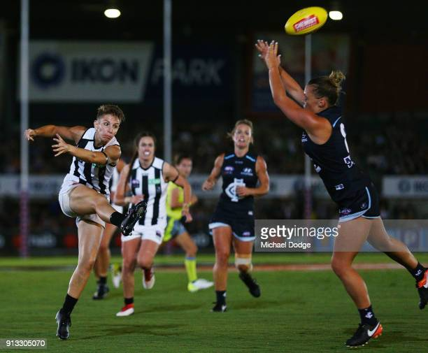Emma Grant of the Magpies kicks the ball during the round one AFLW match between the Carlton Blues and the Collingwood Magpies at Ikon Park on...