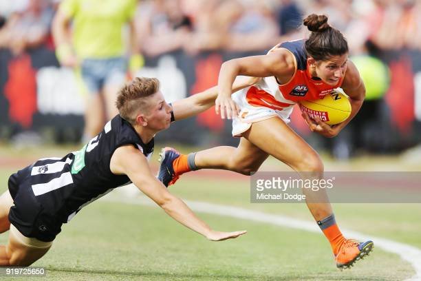 Emma Grant of the Magpies tackles Jessica Dal Pos of GWS during the round three AFLW match between the Collingwood Magpies and the Greater Western...