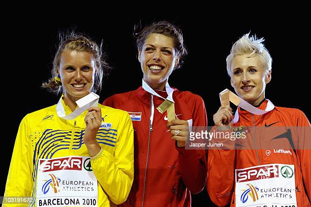 Emma Green of Sweden receives the silver medal Blanka Vlasic of Croatia receives the gold medal and Ariane Friedrich of Germany receives the bronze...