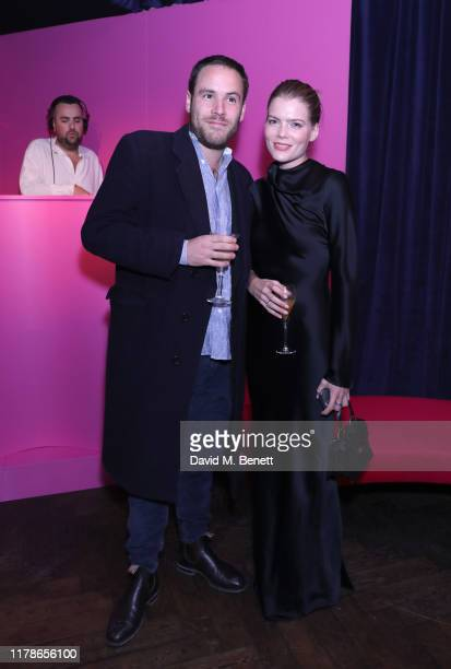 Emma Greenwell and guest attend the Moda Operandi x Brandon Maxwell party on October 02 2019 in London England