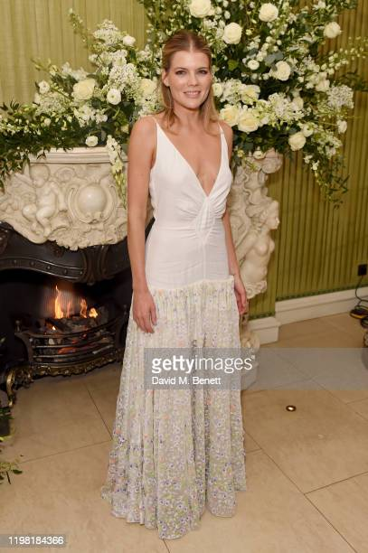 Emma Greenwell attends the British Vogue and Tiffany Co Fashion and Film Party at Annabel's on February 2 2020 in London England