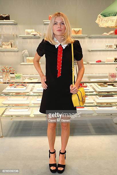 Emma Greenwell attends the Miu Miu Cocktail Party for the SS17 Collection at Miu Miu New Bond Street on December 7 2016 in London England