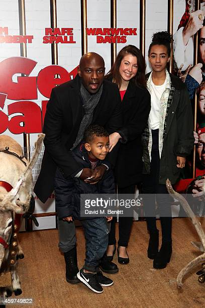 Emma Gyasi and David Gyasi attend the UK Premiere of Get Santa at Vue West End on November 30 2014 in London England