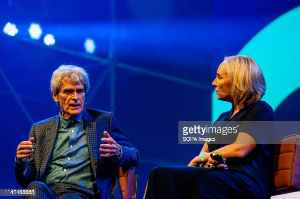 Emma Harman and Sir John Hegarty are seen discussing during The Next Web conference. The 14th edition of The Next Web conference was inaugurated in...