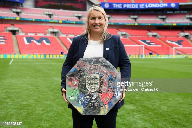Emma Hayes Head Coach of Chelsea Women's celebrates with the Community Shield Trophy following her team's victory in the Women's FA Community Shield...