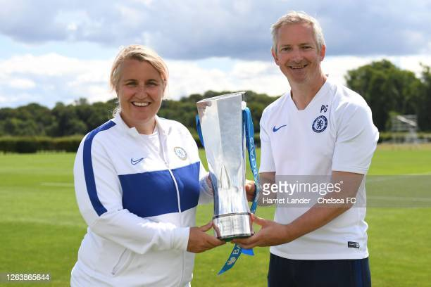 Emma Hayes Manager of Chelsea and Paul Green Assistant Manager of Chelsea pose for a photo with the Barclays FA Women's Super League trophy following...
