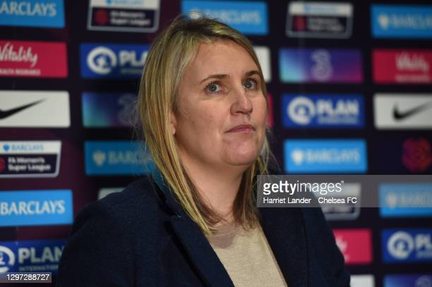 Emma Hayes, Manager of Chelsea looks on as she is interviewed following the Barclays FA Women's Super League match between Chelsea Women and...