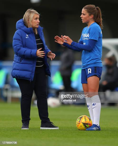 Emma Hayes manager of Chelsea talks to Melanie Leupolz of Chelsea prior to the Barclays FA Women's Super League match between Chelsea Women and...