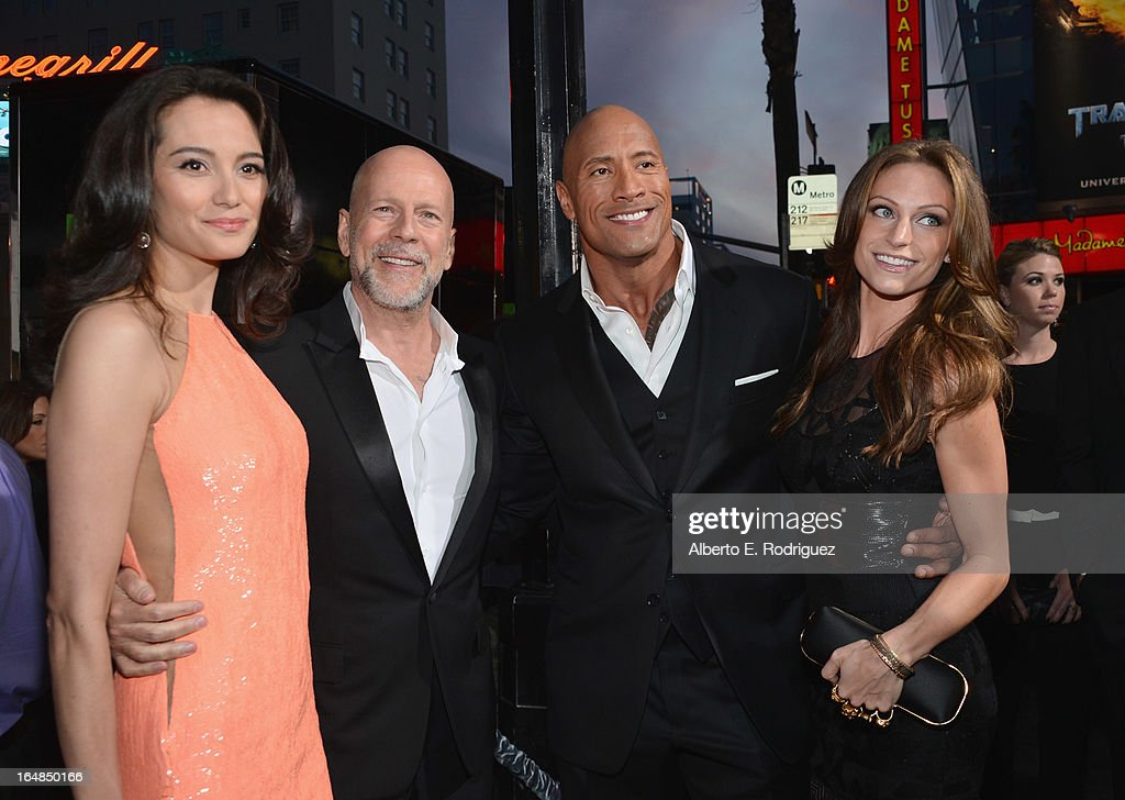 Emma Heming, actor Bruce Willis, Dwayne 'The Rock' Johnson and Lauren Hashian attends the premiere of Paramount Pictures' 'G.I. Joe: Retaliation' at TCL Chinese Theatre on March 28, 2013 in Hollywood, California.