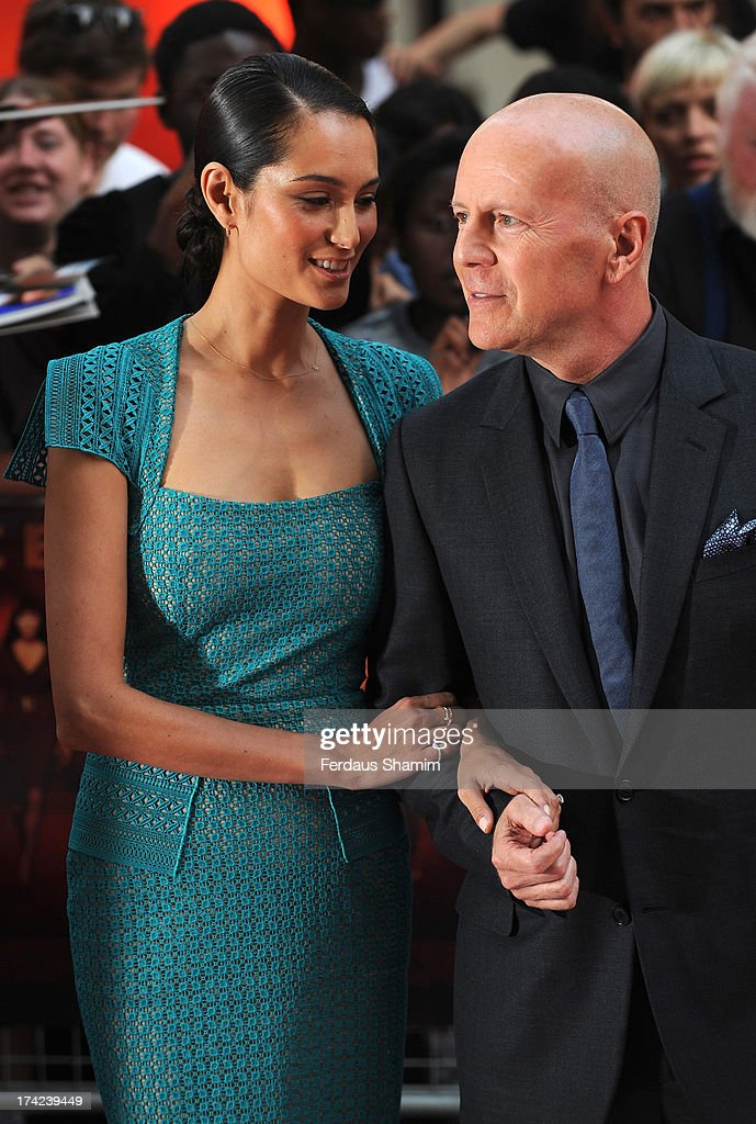 Emma Heming and Bruce Willis attend the European Premiere of 'Red 2' at Empire Leicester Square on July 22, 2013 in London, England.