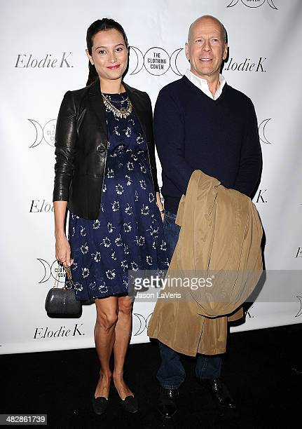 Emma Heming and Bruce Willis attend the launch of 'The Clothing Coven' at Elodie K on April 4 2014 in West Hollywood California
