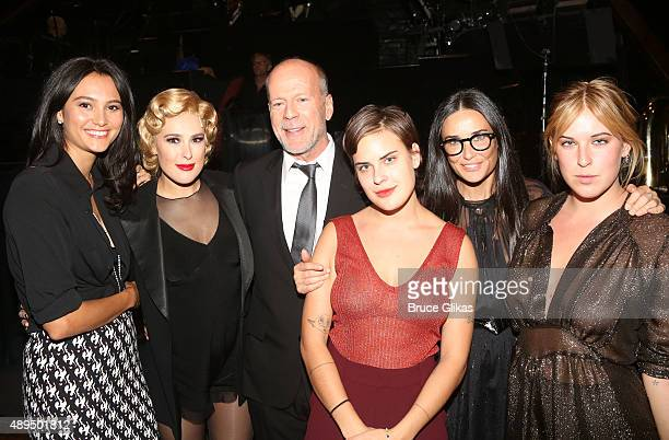 Emma Heming, Rumer Willis, father Bruce Willis, sister Tallulah Belle Willis, mother Demi Moore and sister Scout LaRue Willis pose backstage as Rumer...