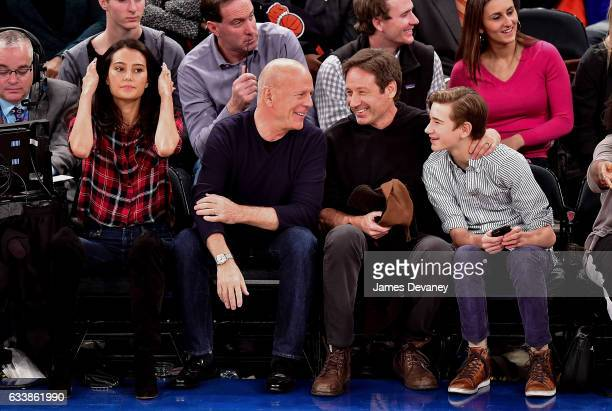 Emma Heming Willis Bruce Willis David Duchovny and Kyd Miller Duchovny attend Cleveland Cavaliers Vs New York Knicks game at Madison Square Garden on...