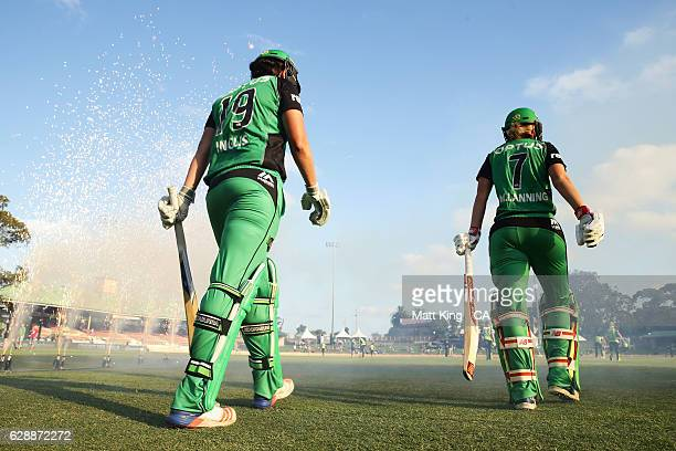 Emma Inglis and Meg Lanning of the Stars walk onto the field to bat during the Women's Big Bash League match between the Sydney Thunder and the...