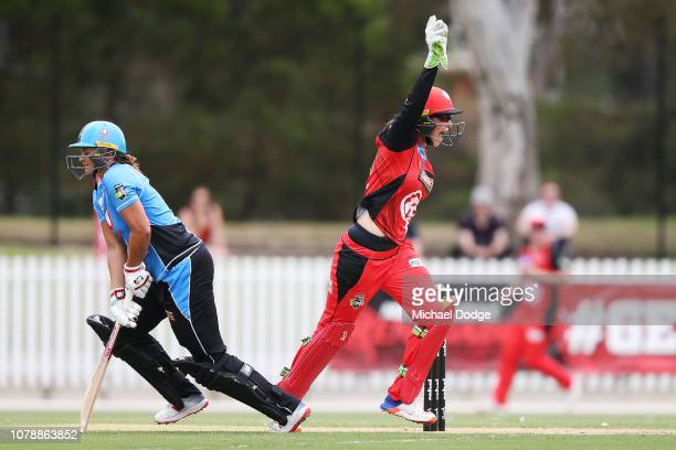 Emma Inglis of the Renegades celebrates her catch to dismiss Suzie Bates of the Strikers during the Women's Big Bash League match between the...