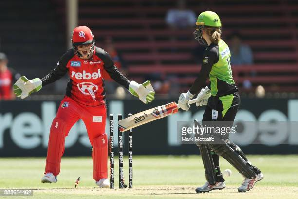 Emma Inglis of the Renegades celebrates the wicket of Rachel Haynes off the Thunder off the bowling of Chamari Atapattu of the Renegades during the...
