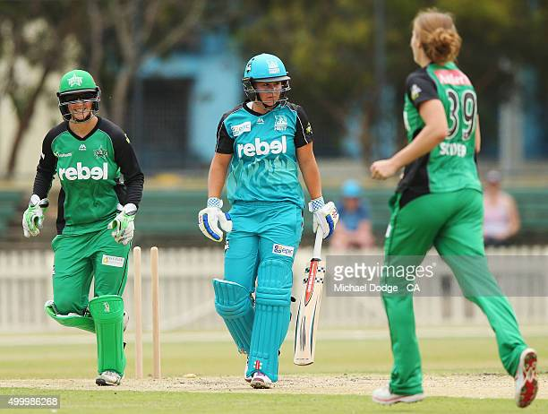 Emma Inglis of the Stars and Natalie Sciver of the Stars celebrate the win as Ash Barty of the Heat walks off during the Women's Big Bash League...