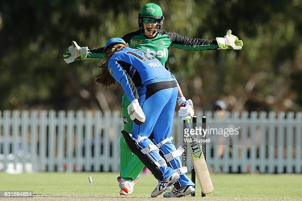 Emma Inglis of the Stars reacts as Alex Price of the Strikers is bowled out during the Women's Big Bash League match between the Adelaide Strikers...