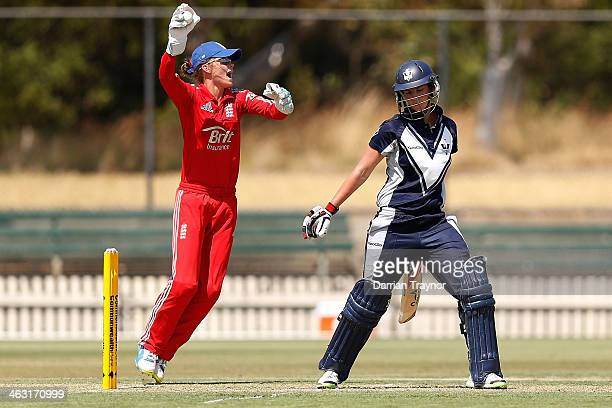 Emma Inglis of Victoria is caught behind by wicketkeeper Amy Jones of England during the International Tour match between the Chairman's XI and...