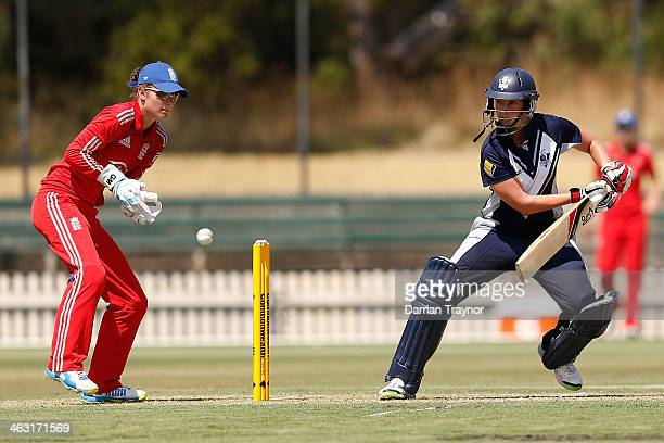 Emma Inglis of Victoria plays a cut shot as wicket keeper Amy Jones of England looks on during the International Tour match between the Chairman's XI...
