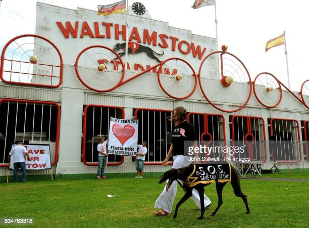 Emma Johns and her greyhound 'Whippy' walk past the main entrance to Walthamstow stadium to join a march to Waltham Forest Town Hall to protest at...