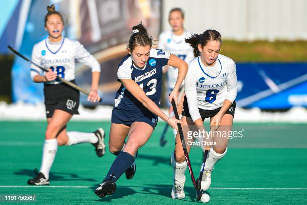 Emma Johns of Middlebury and Ellie Paige of Franklin Marshall battle for possession during the Division III Women's Field Hockey Championship held at...