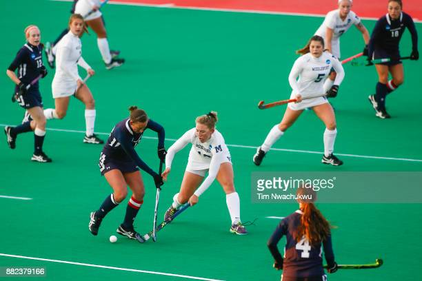 Emma Johns of Middlebury College dispossesses Nicole Wilkerson of Messiah College during the Division III Women's Field Hockey Championship held at...