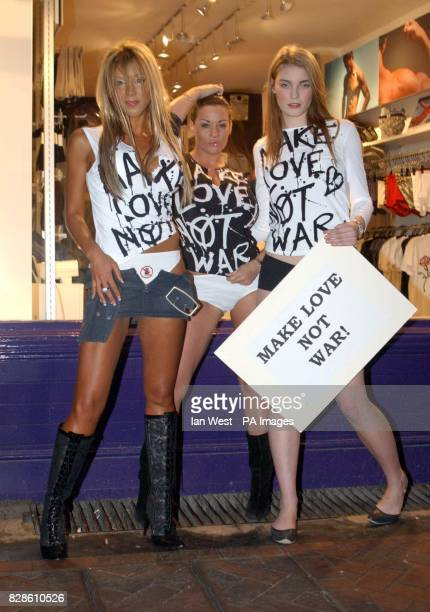 Emma Jones Linsey Dawn McKenzie and Lucy Mans wearing Make Love Not War tshirts during a photocall outside the Aware lingerie shop in London's...