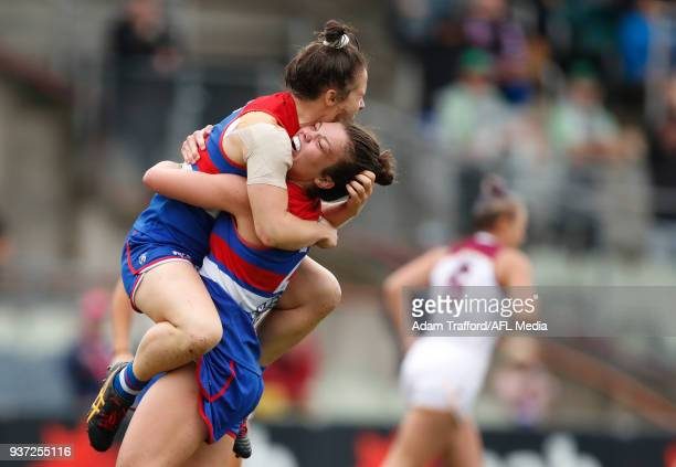 Emma Kearney of the Bulldogs celebrates a goal with Ellie Blackburn of the Bulldogs during the 2018 AFLW Grand Final match between the Western...
