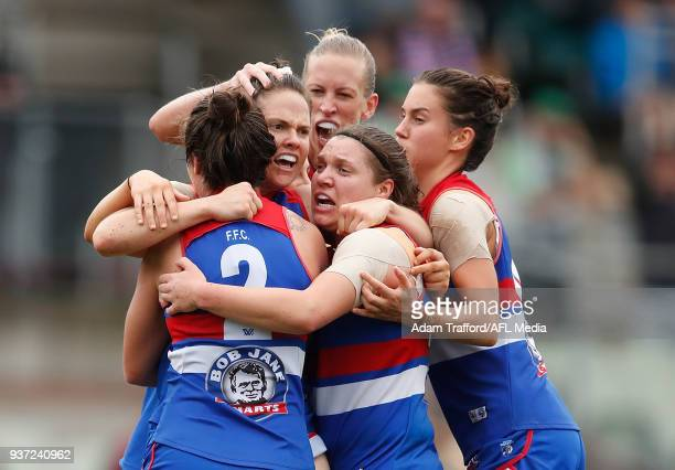 Emma Kearney of the Bulldogs celebrates a goal with teammates LR Ellie Blackburn Lauren Spark Kirsty Lamb and Libby Birch during the 2018 AFLW Grand...