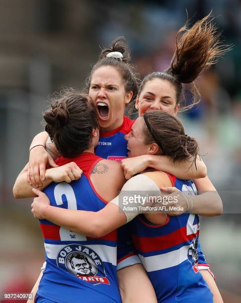 Emma Kearney of the Bulldogs celebrates a goal with teammates LR Ellie Blackburn Monique Conti and Kirsty Lamb during the 2018 AFLW Grand Final match...