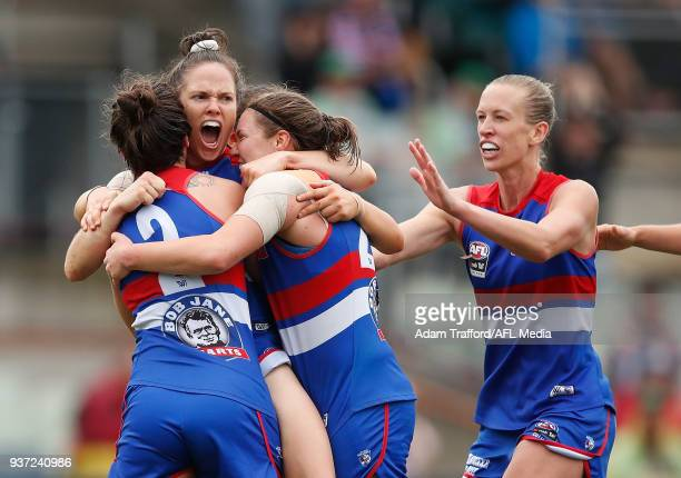 Emma Kearney of the Bulldogs celebrates a goal with teammates LR Ellie Blackburn Kirsty Lamb and Lauren Spark during the 2018 AFLW Grand Final match...