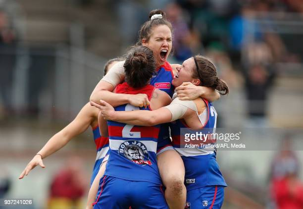 Emma Kearney of the Bulldogs celebrates a goal with teammates LR Ellie Blackburn and Kirsty Lamb during the 2018 AFLW Grand Final match between the...