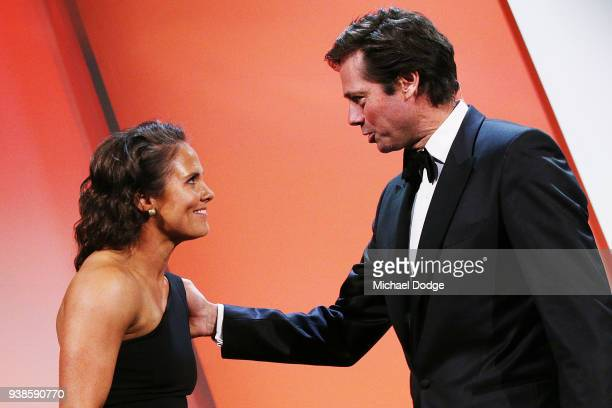 Emma Kearney of the Bulldogs is congratulated by AFL CEO Gillon Mclachlan after winning the AFLW Medal during the 2018 AFW Awards at The Peninsula on...