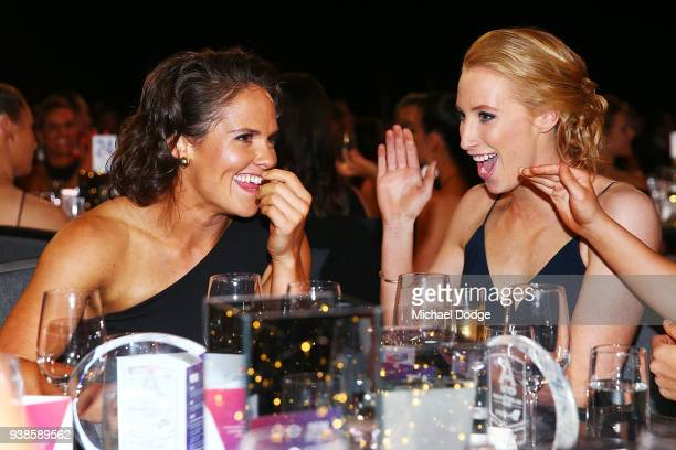 Emma Kearney of the Bulldogs reacts next to Kate Shierlaw on winning the AFLW Medal the 2018 AFW Awards at The Peninsula on March 27 2018 in...