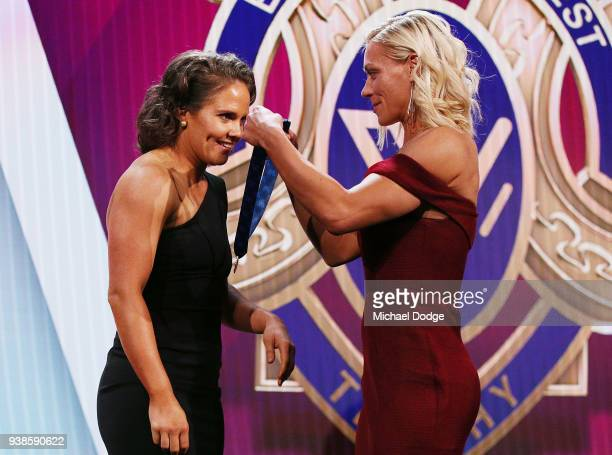 Emma Kearney of the Bulldogs receives the AFLW Medal from previous winner Erin Phillips of the Crows the 2018 AFW Awards at The Peninsula on March 27...