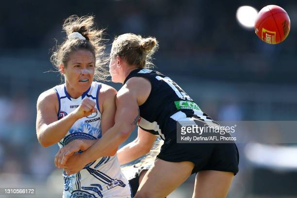 Emma Kearney of the Kangaroos handballs during the AFLW Finals Series match between the Collingwood Magpies and the North Melbourne Kangaroos at...