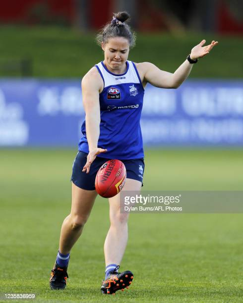 Emma Kearney of the Kangaroos kicks the ball during the North Melbourne training session at Arden Street Oval on October 12, 2021 in Melbourne,...