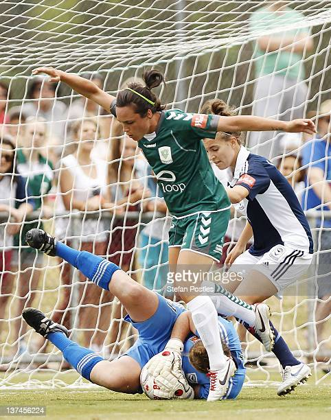 Emma Kete of Canberra United attempts to beat Melbourne Victory goal keeper Brianna Davey to the ball during the WLeague Semi Final match between...