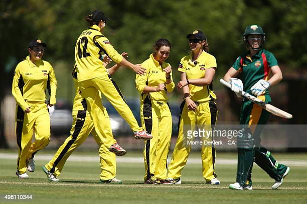 Emma King of the Fury celebrates with teammates after getting a wicket during the WNCL match between Tasmania and Western Australia at Park 25 on...