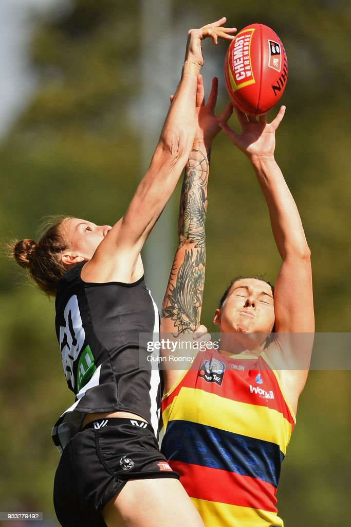 Emma King of the Magpies and Rhiannon Metcalfe of the Crows compete for a mark during the round seven AFLW match between the Collingwood Magpies and the Adelaide Crows at Olympic Park on March 18, 2018 in Melbourne, Australia.