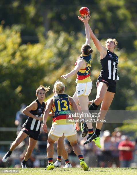 Emma King of the Magpies and Sarah Allan of the Crows compete in a ruck contest during the 2017 AFLW Round 07 match between the Collingwood Magpies...
