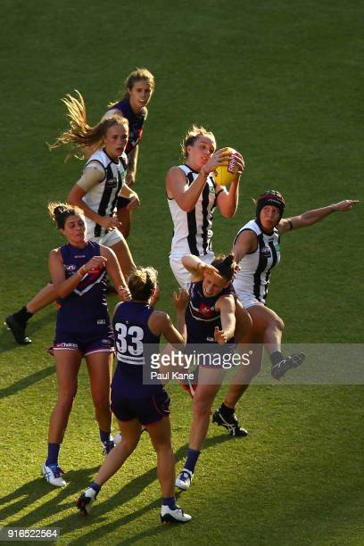 Emma King of the Magpies takes a contested mark during the round two AFLW match between the Fremantle Dockers and the Collingwood Magpies at Optus...