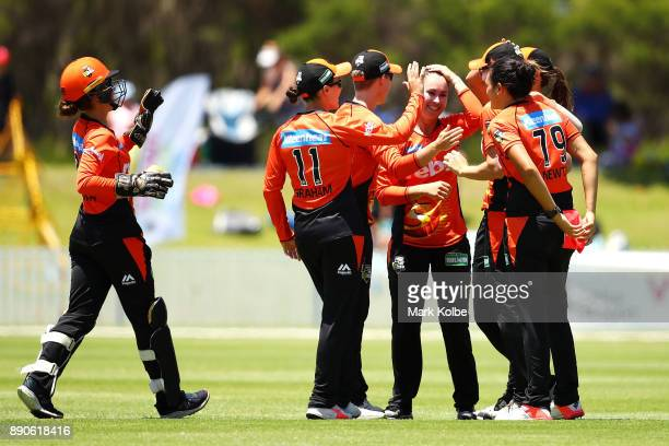Emma King of the Scorchers celebrates with her team after taking the wicket of Ashleigh Gardner of the Sixers during the Women's Big Bash League...