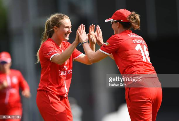 Emma Lamb of Lancashire celebrates with Kate Cross after getting Heather Knight out during the Kia Super League match between Lancashire Thunder AND...